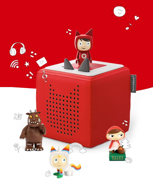 Red Tonie Box with a character sitting on top and the Grufalolo and Little Red Riding Hood sitting on the table