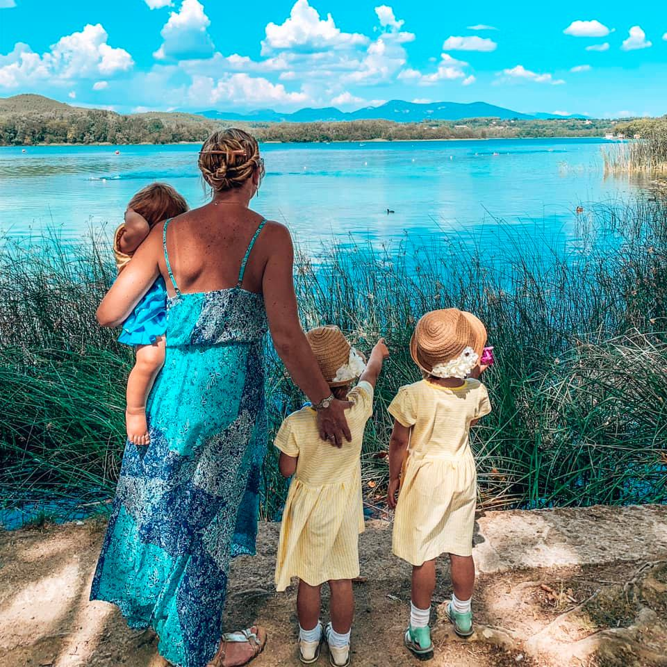 Banyole Lake Spain. Mummy with children looking out across the lake counting the ducks