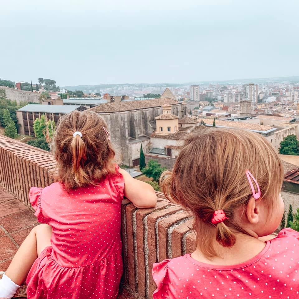 Girona Wall with twins looking across the city below