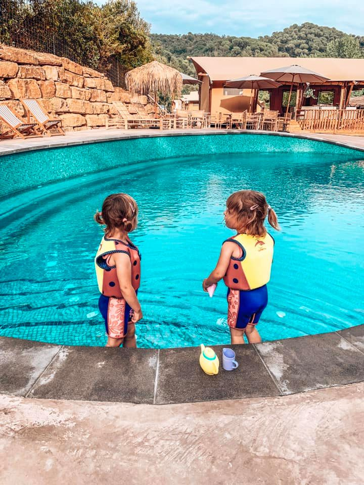 Twins playing in the pool at Can Bora Lodges