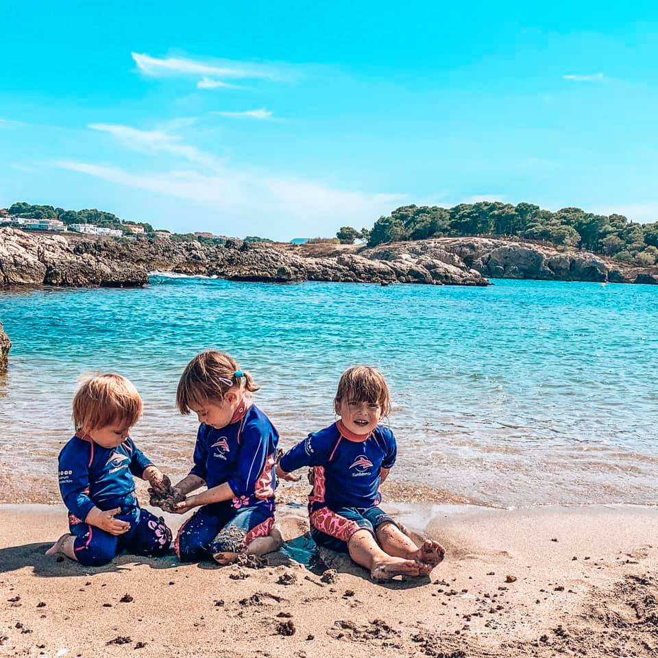 Children playing on the beach in the sand in Spain