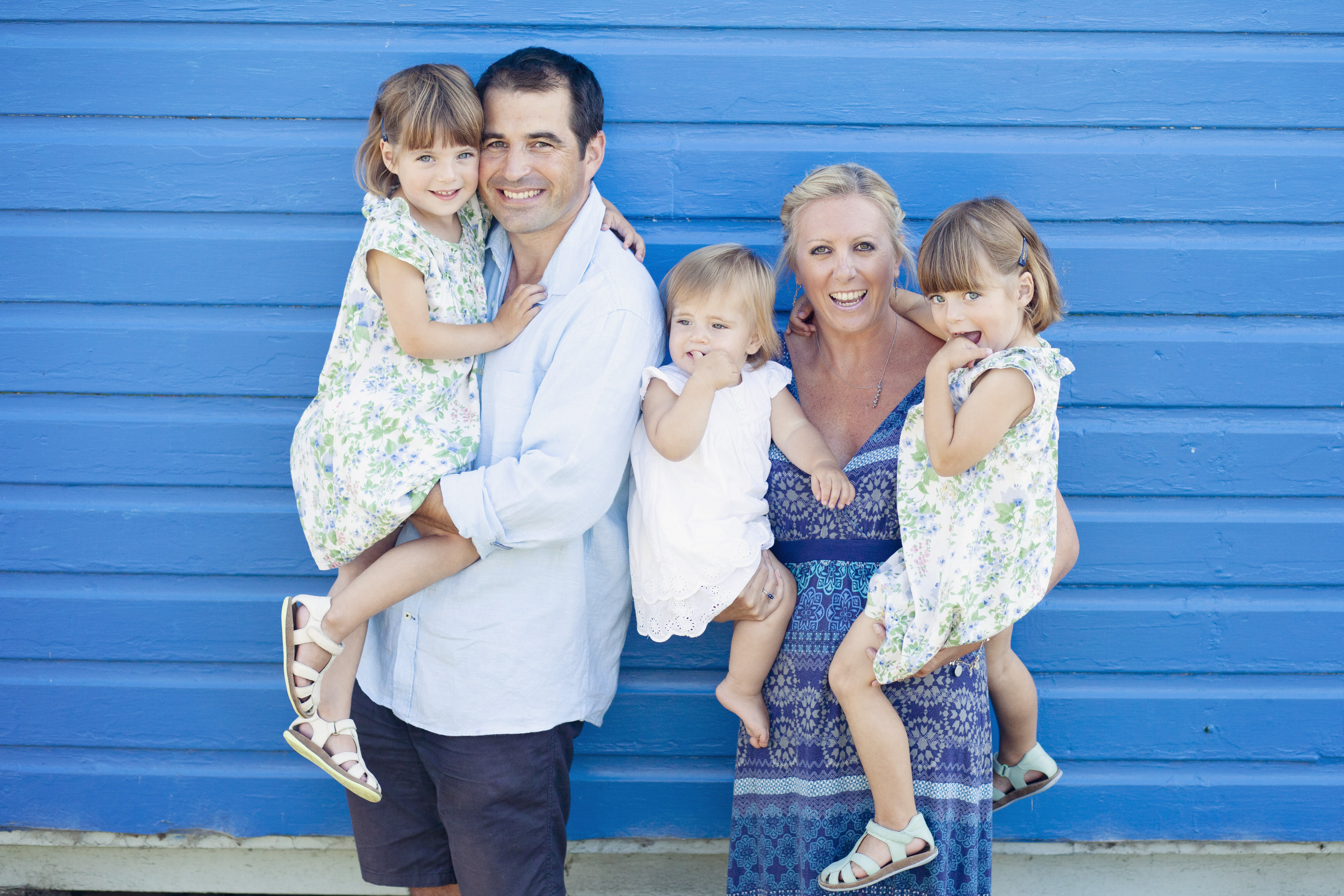 The Miller family. Mum, dad, twin girls and one year old posing for a photo