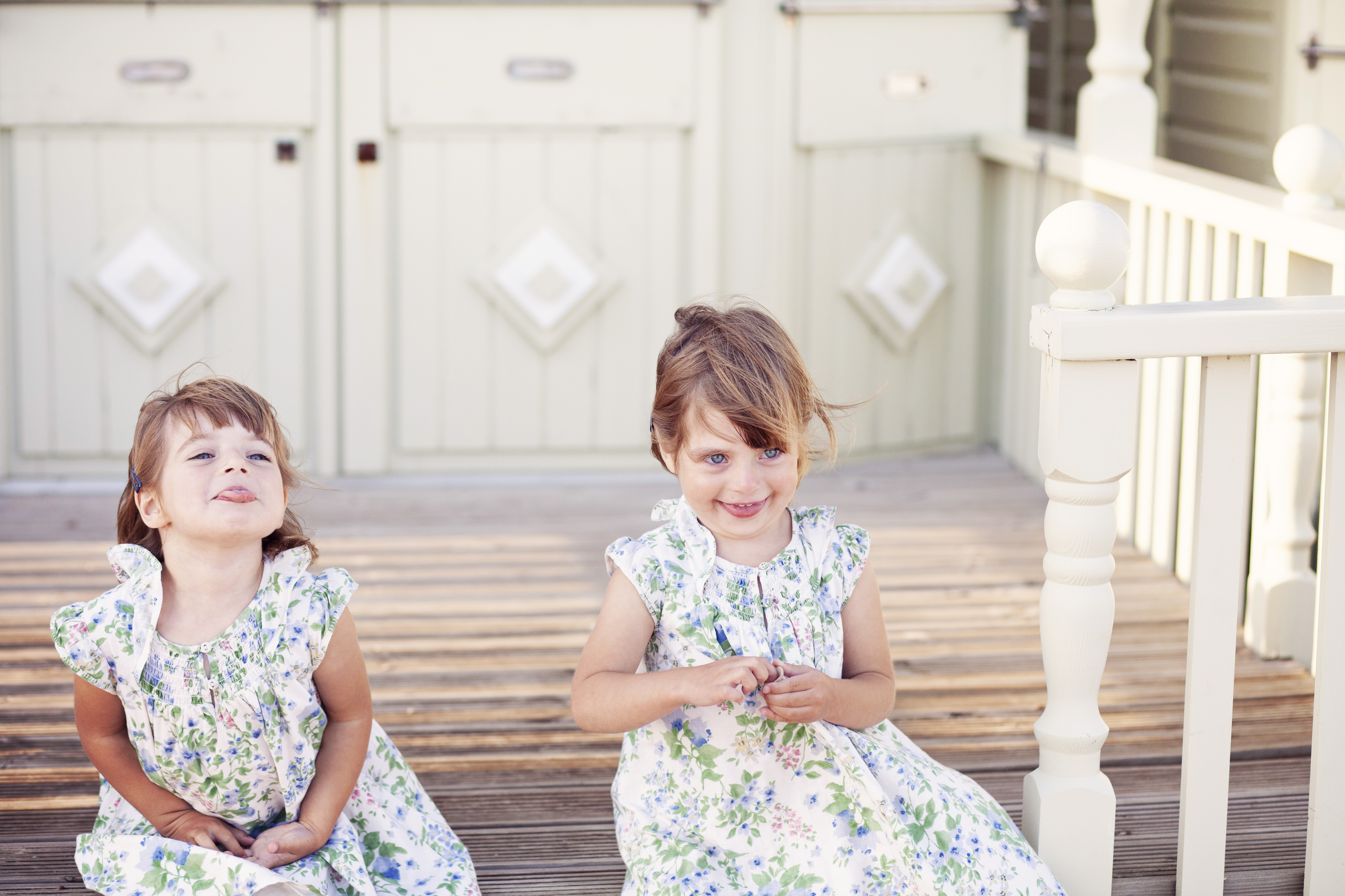 Twins playing on a beach hut