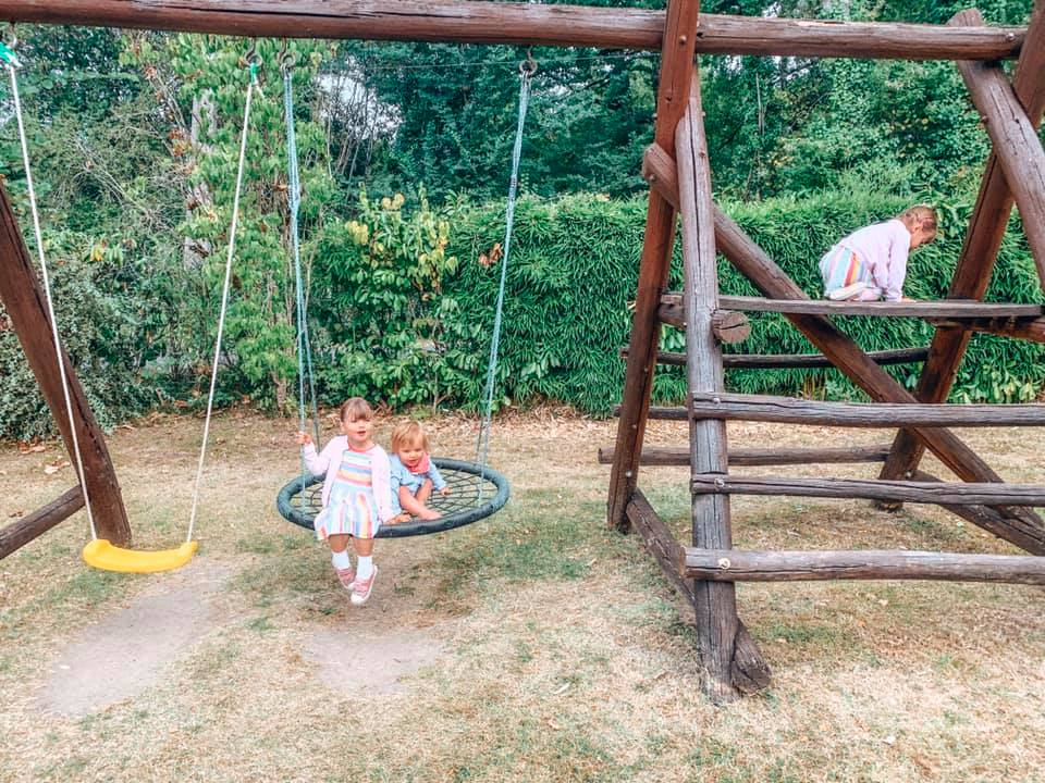 Children swimming on a swing
