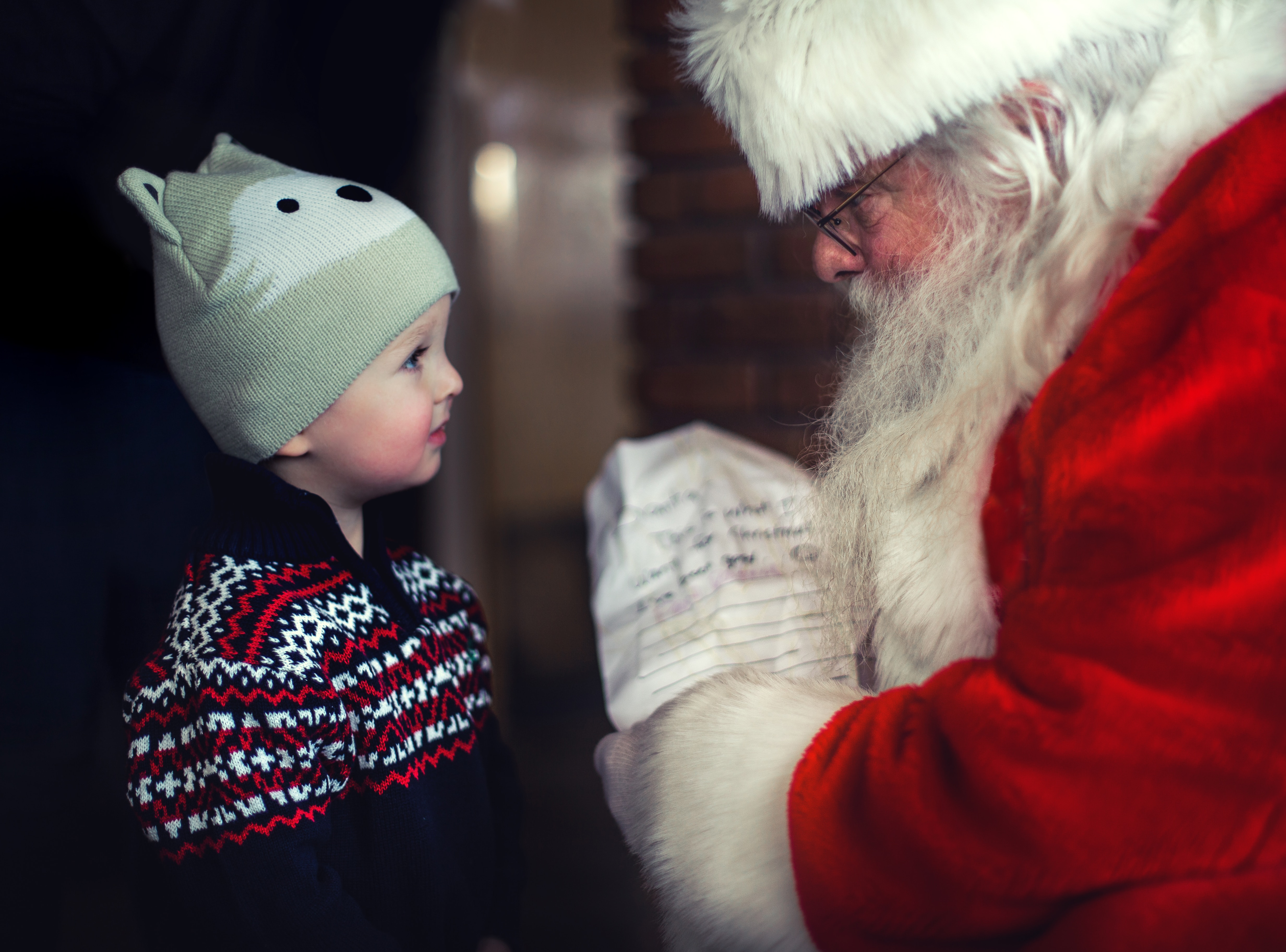 Father Christmas passing a present to a young boy