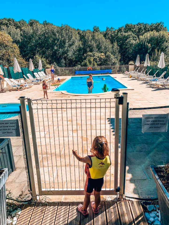 Child standing at the swimming gate
