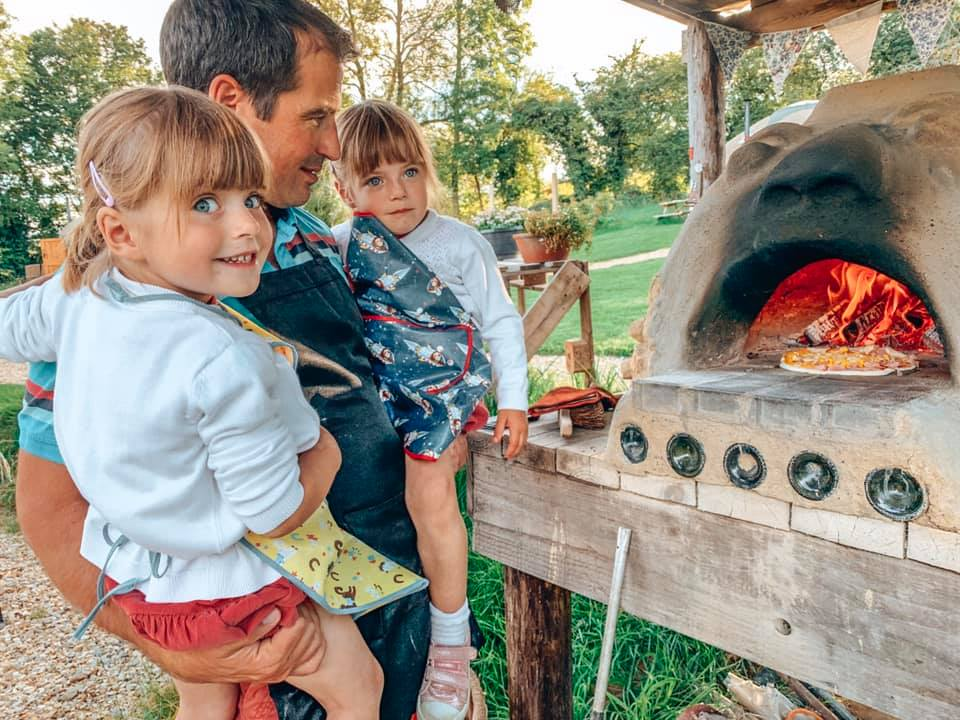 watching the pizza cook in the stone oven