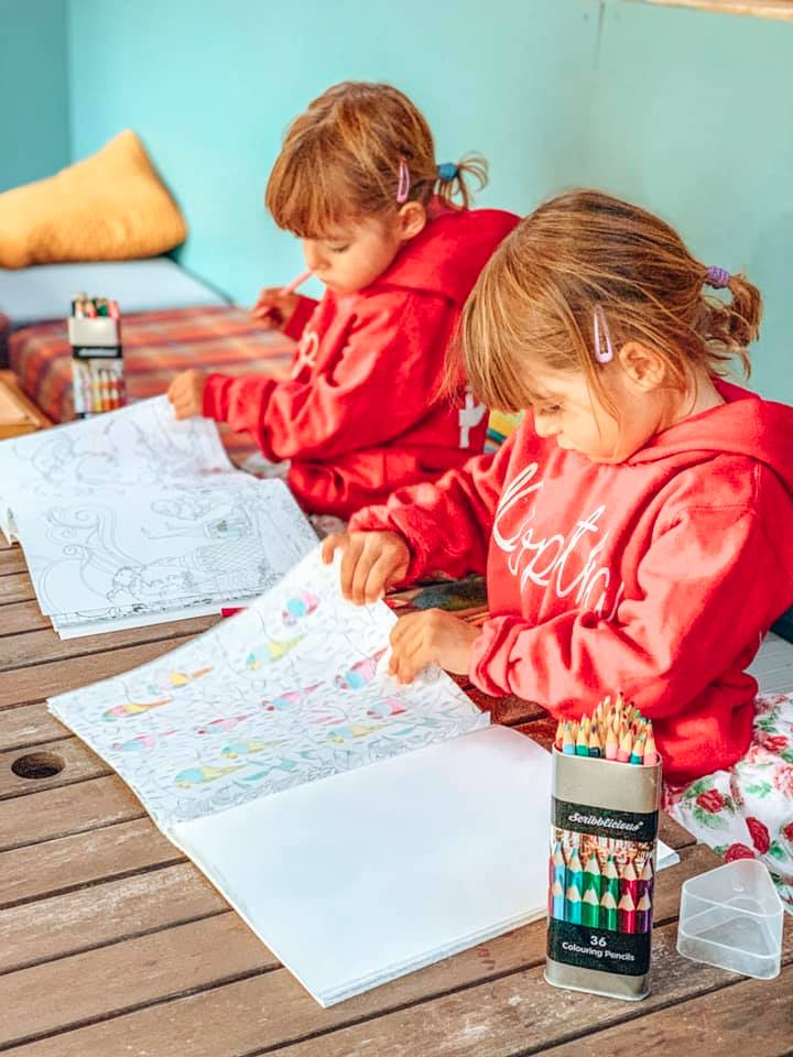 children colouring on a table