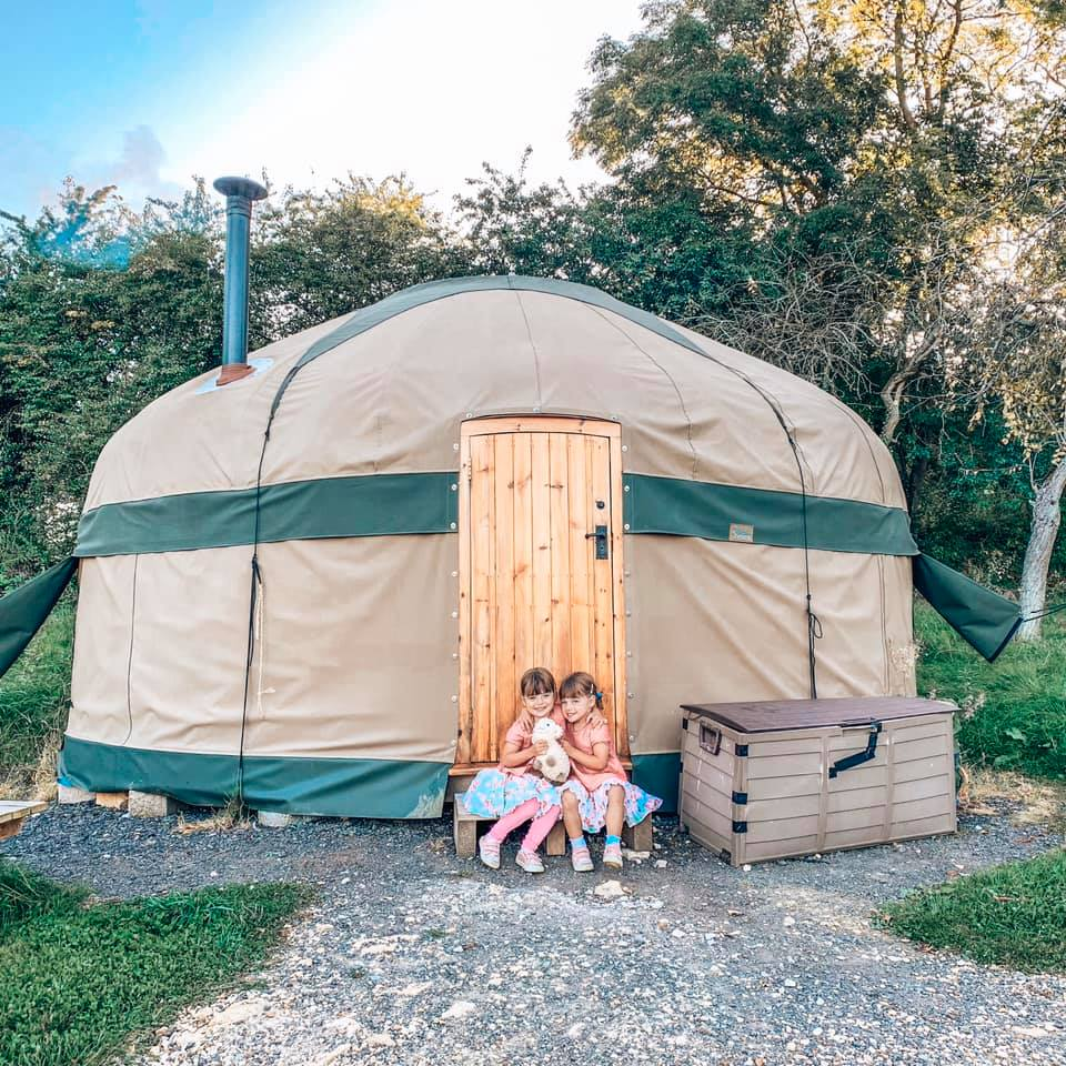 Campden Yurts with twin girls sitting by the door