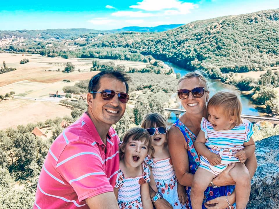 Family photo overlooking the Dordogne in France. The perfect twin and toddler friendly holiday.