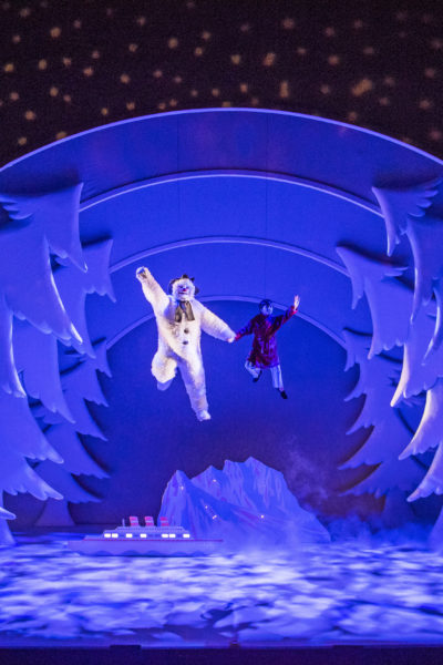 The Snowman and Boy flying through the air