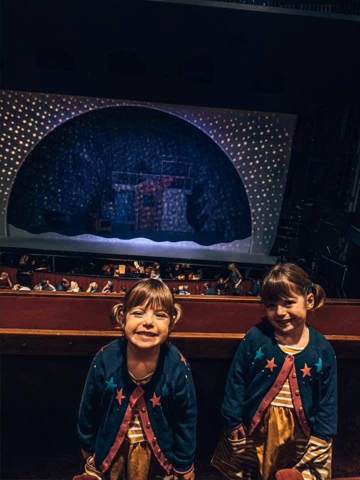 twins standing in the Peacock Theatre