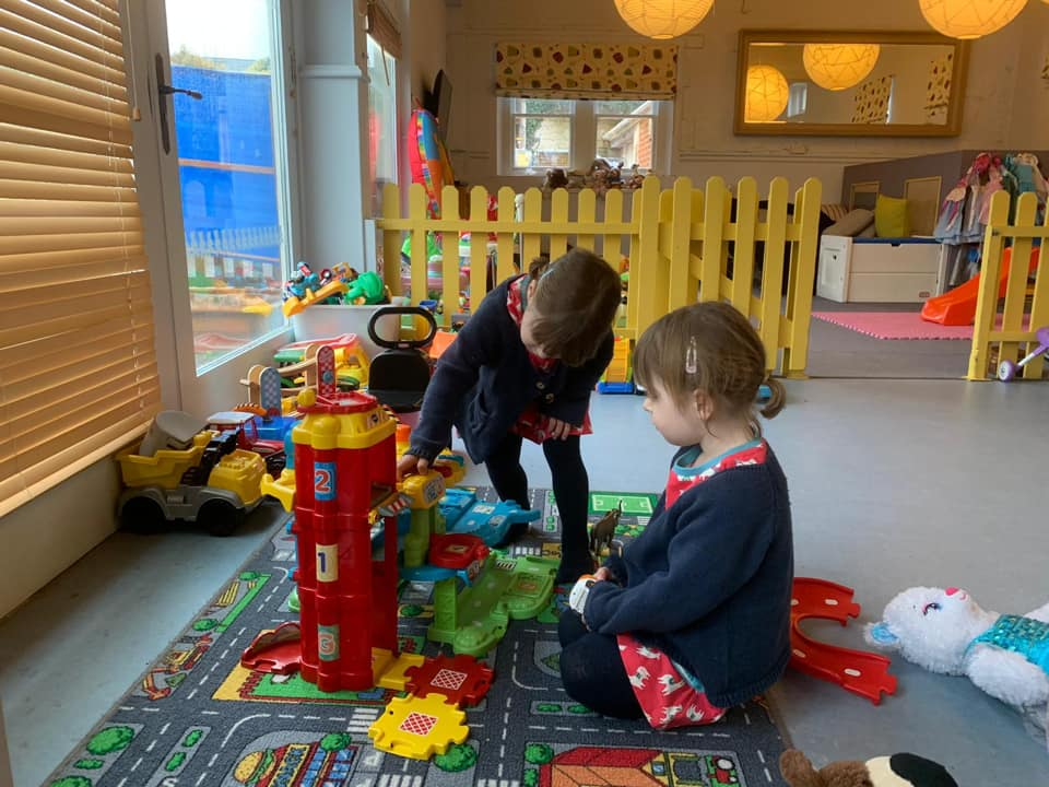 The Woolley Grange is a wonderful twin and toddler friendly holiday. Children playing with the cars in the kids club.