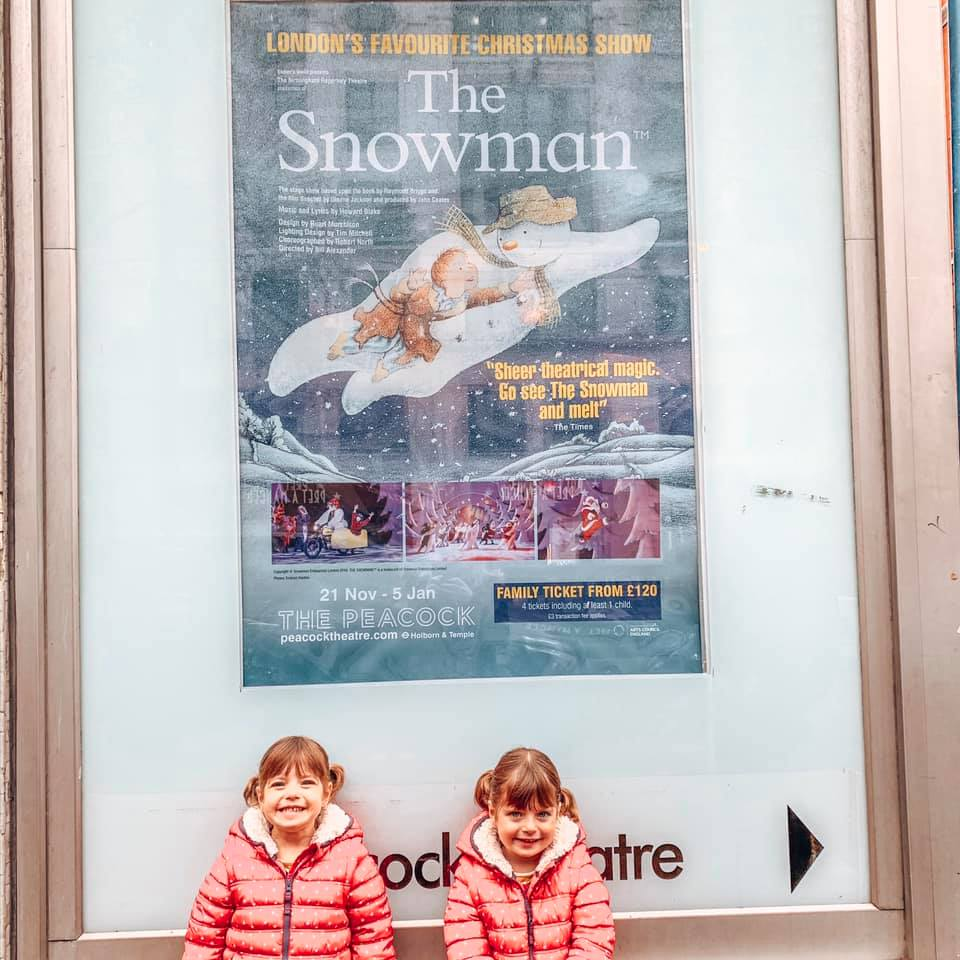 twins standing by The Snowman poster