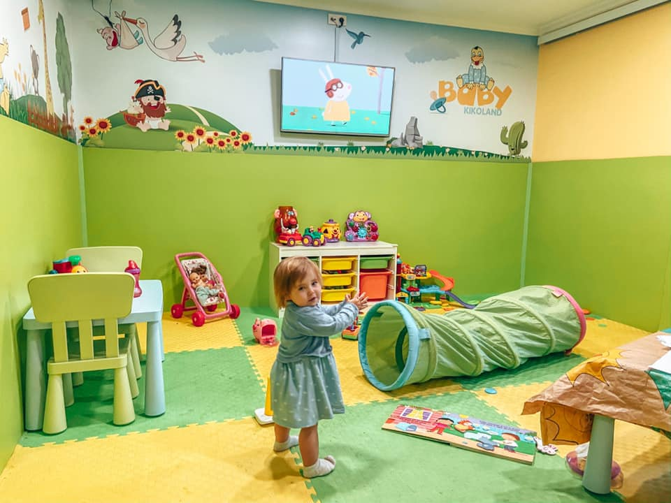 Baby Kikoland creche for under 3's. Baby playing with toys