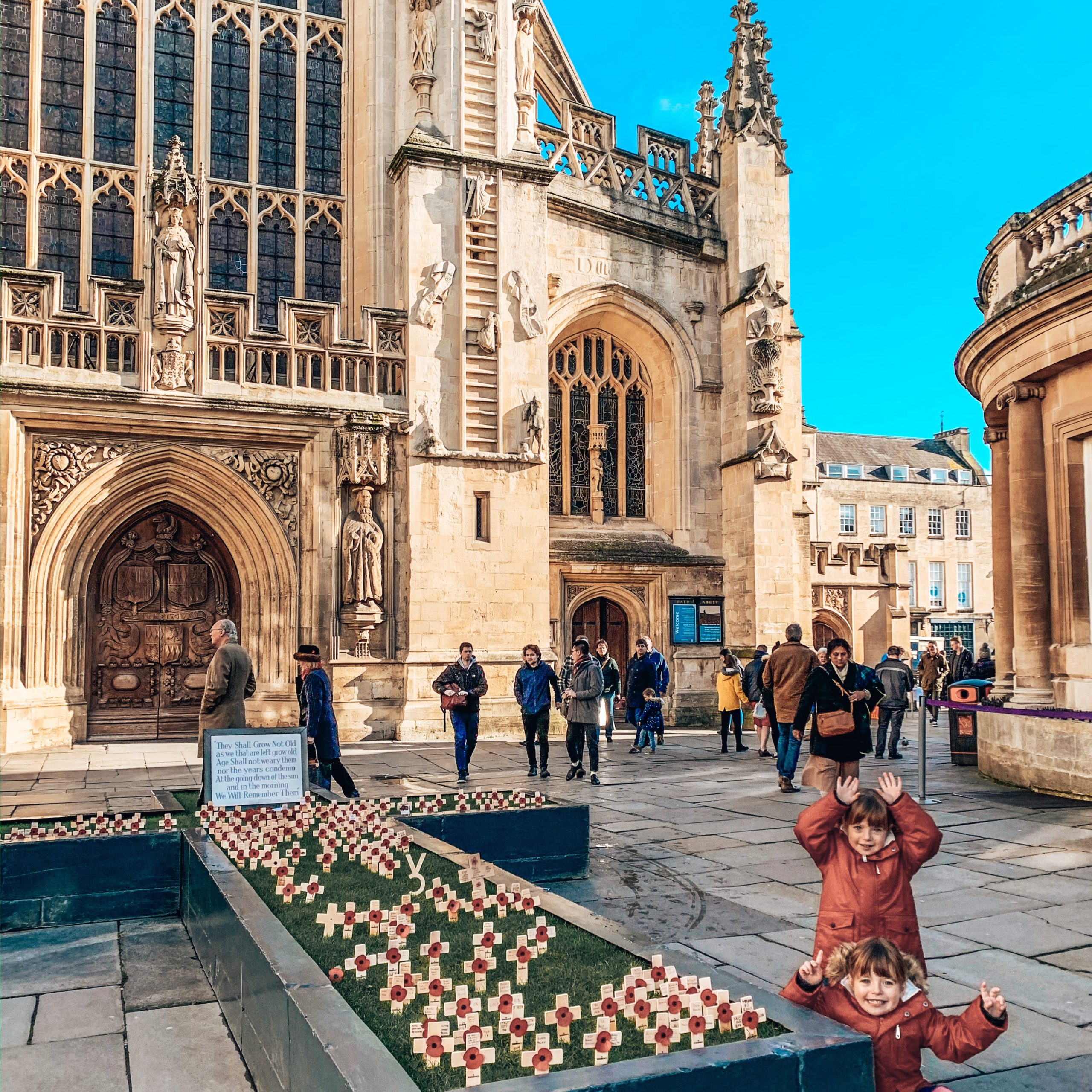 the centre of Bath with kids outside Bath Abbey
