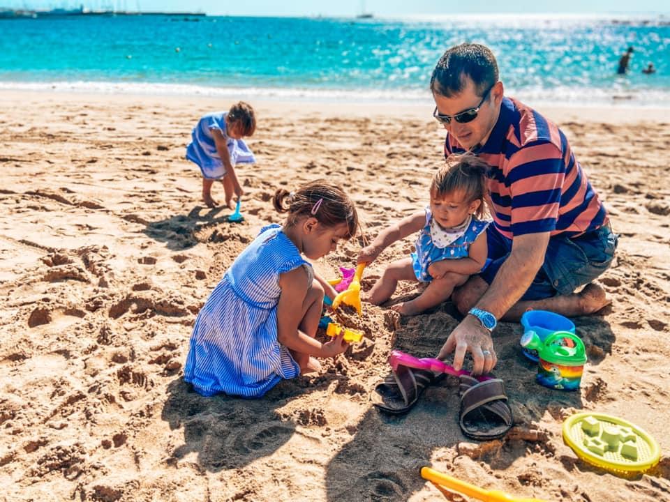 Family playing on Yaiza beach