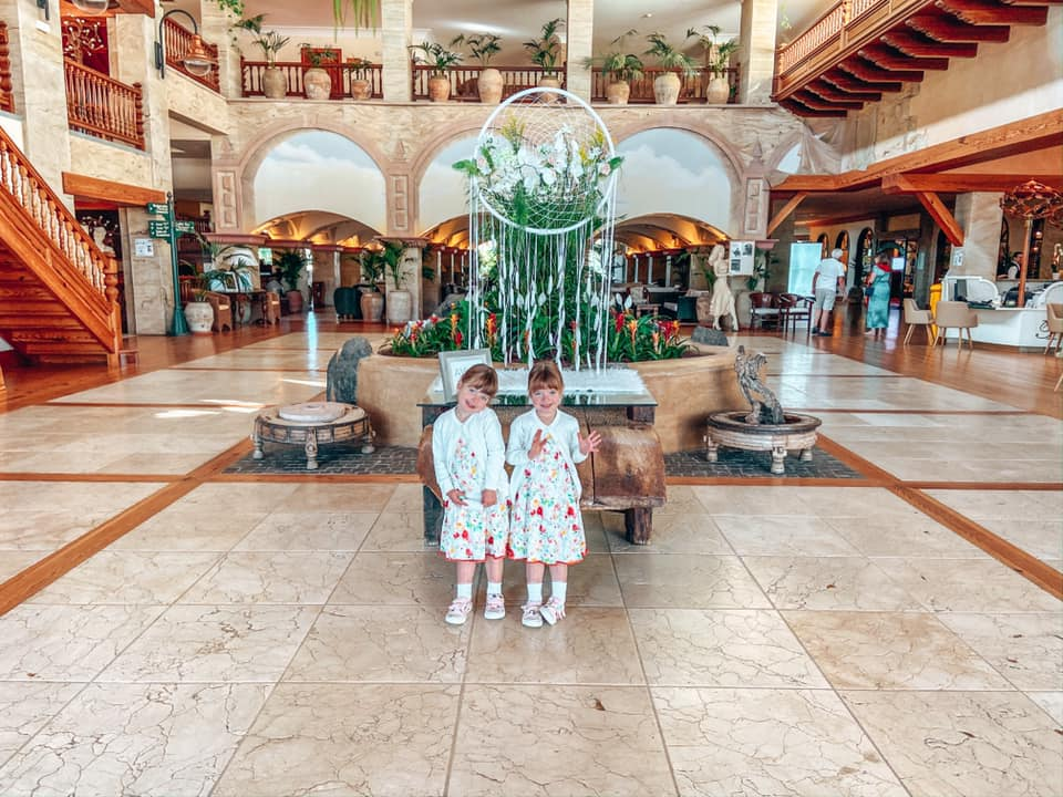 Twins standing in the entrance of the Princesa Yaiza, Lanzarote