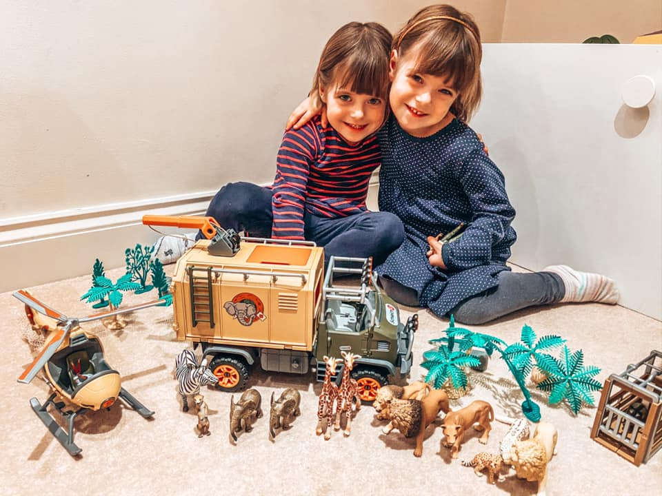 Children playing with the New Schleich Wild life Helicopter and Safari rescue truck and surrounded by Schleich animals