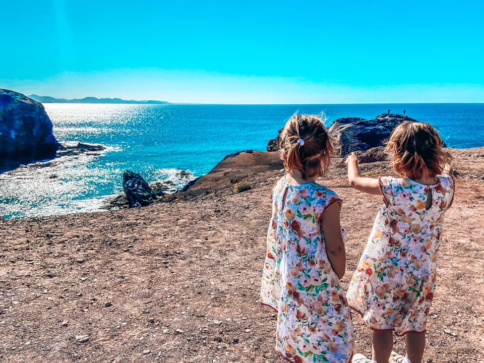 Twin girls looking over the bay at Papogayo beach