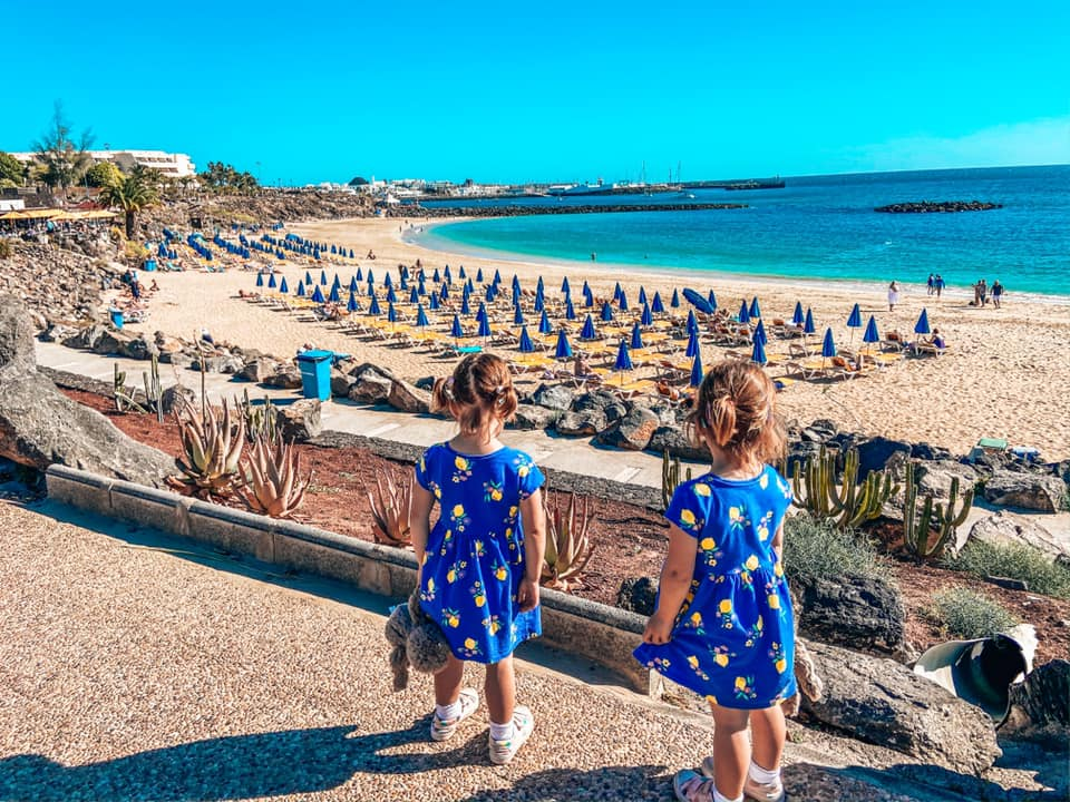 Twins looking over the beach in Yaiza