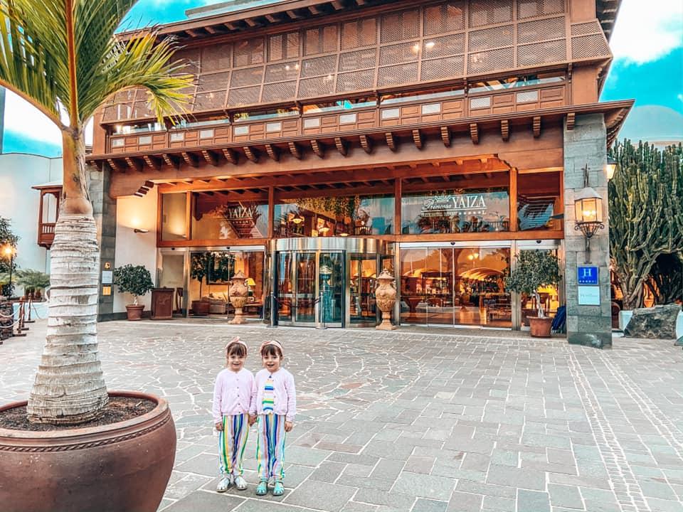 Twin girls standing outside the entrance of the Princesa Yaiza, Lanzarote