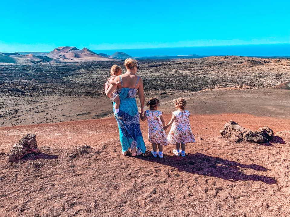 Family overlooking the Volcanic landscape in Lanzarote