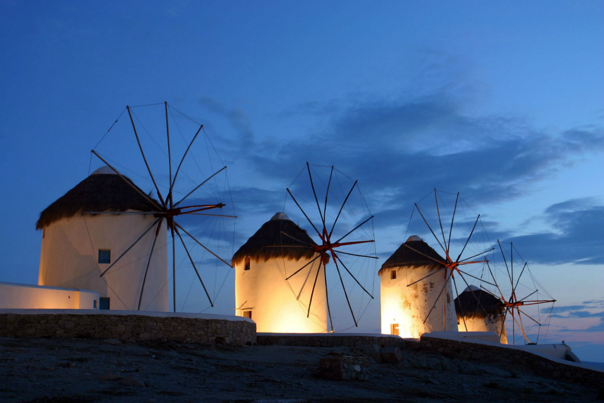 picture of the Mykonos windmills lit up at night