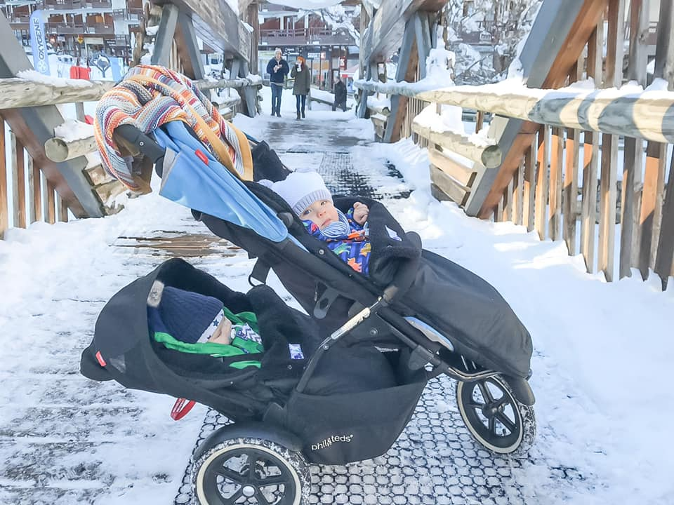 babies in a buggy in the snow