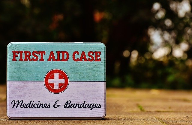 image of a 'first aid case' with 'medicines & bandages' written on the front