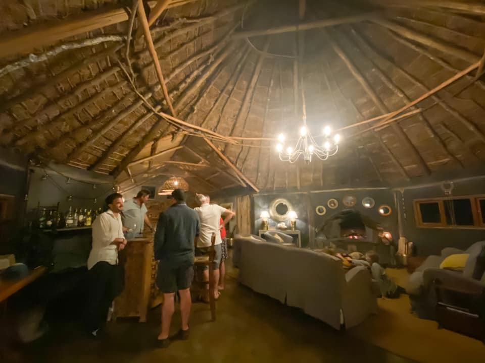 bar at the house on the wild resort inside a thatched roofed hut and chandelier