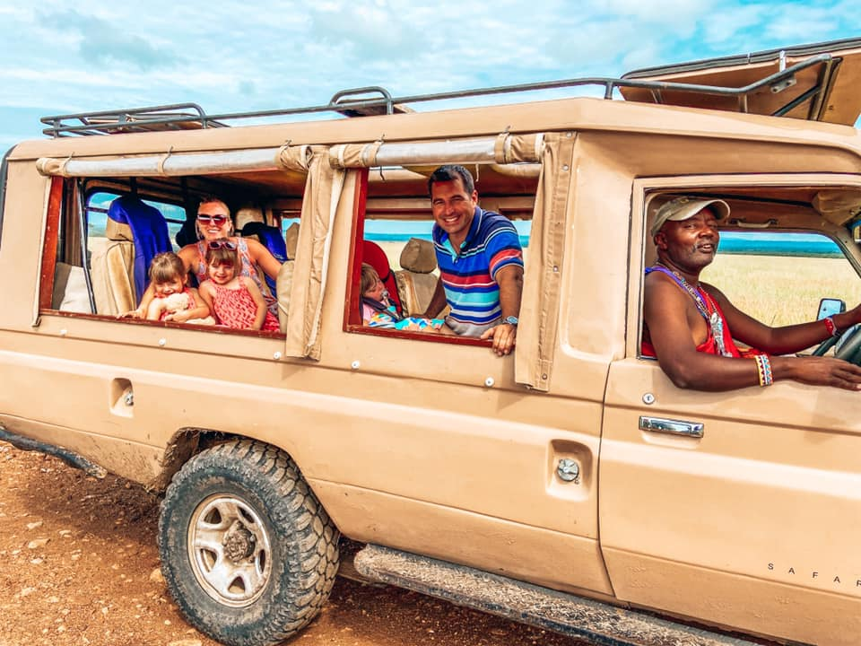 family on a Maasai Mara safari jeep with Kids