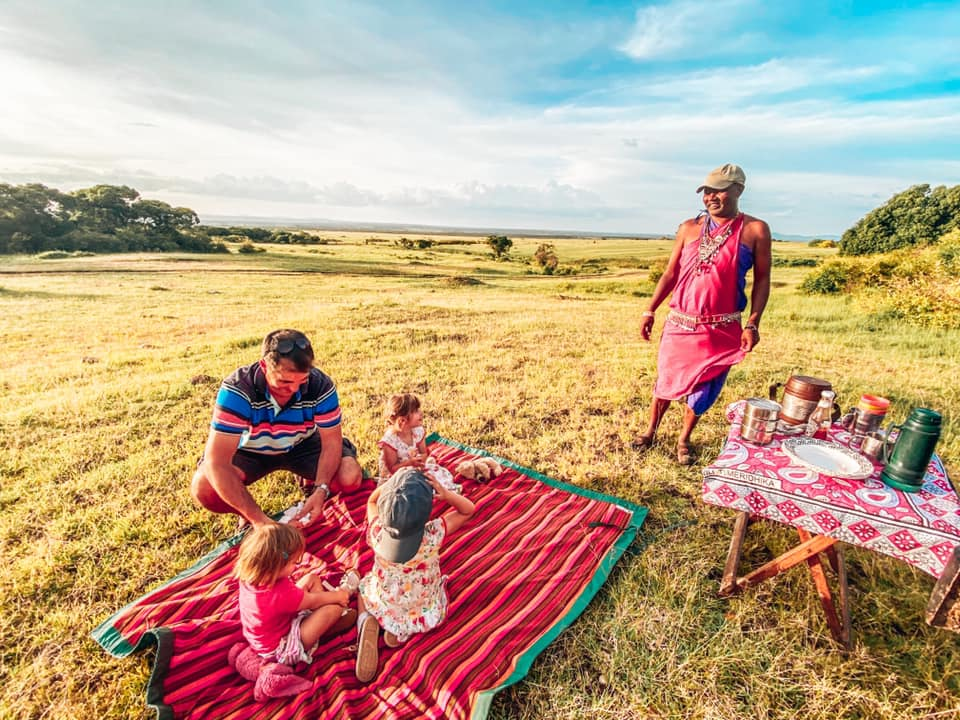 family on a blanket in Maasai Mara with Kids sundowners