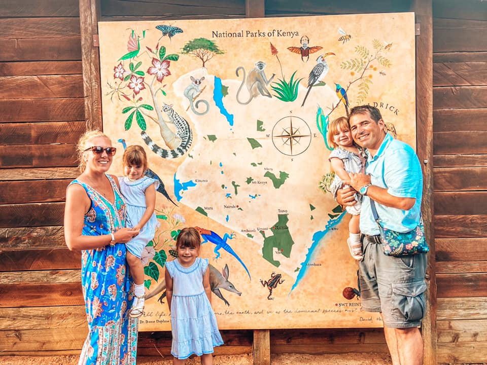 image of family in front of map of national parks of kenya