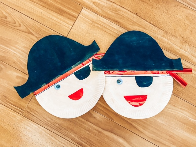 two paper plate pirates with cardboard hats and an eye patch