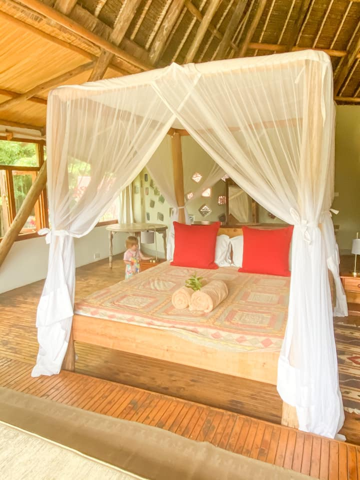 picture of the bed inside villa in the wild