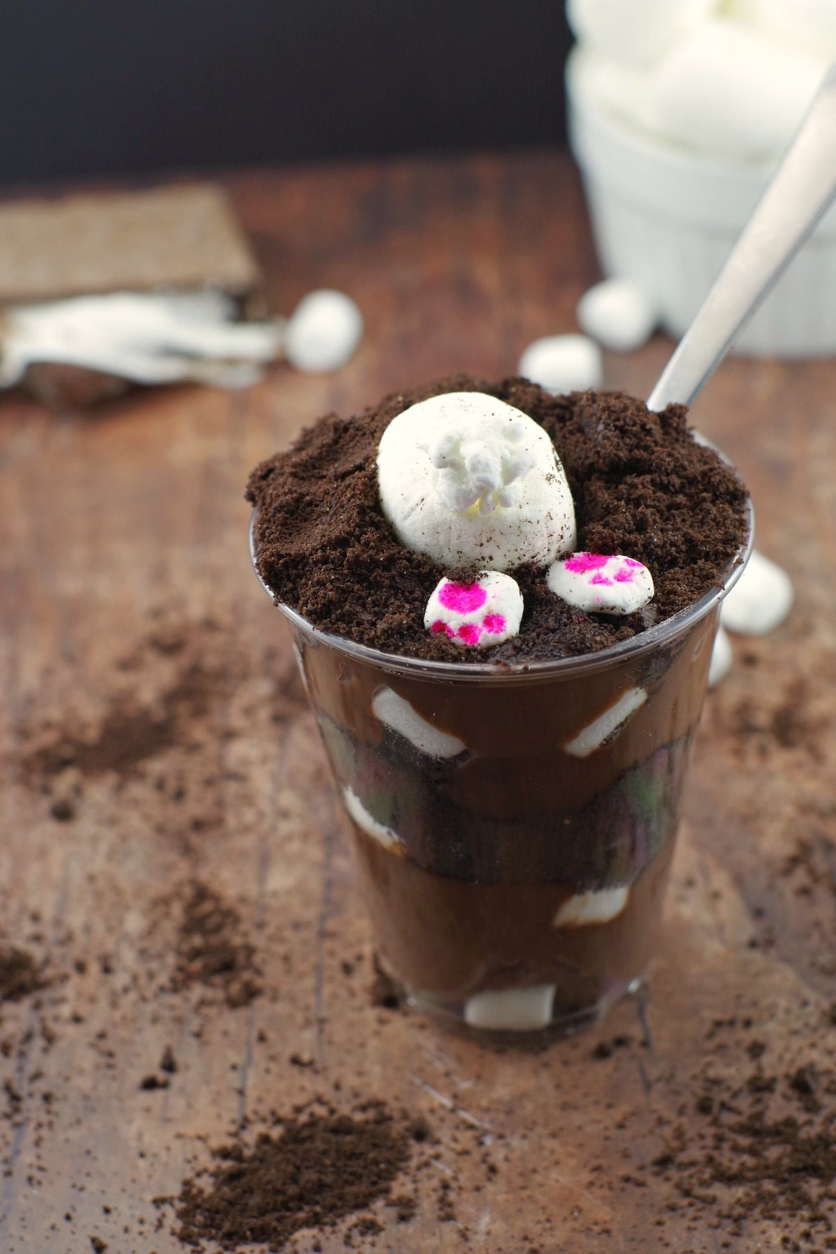plastic cup filled with chocolate cake and an bunny bottom sticking out of the top