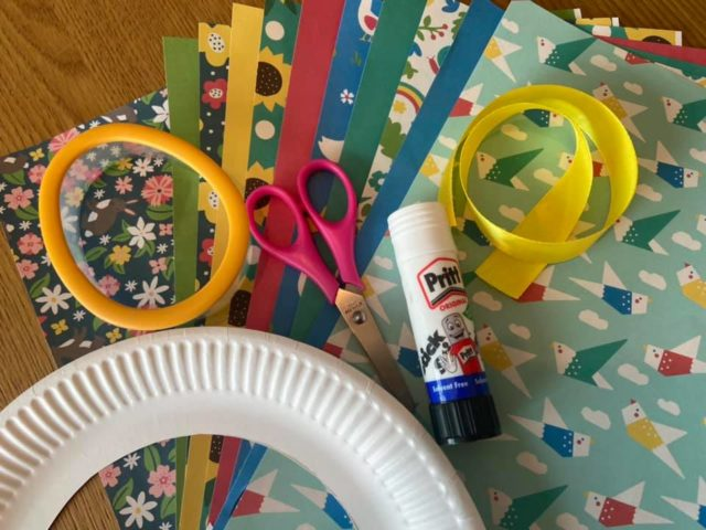craft materials to make an Easter wreath. Paper plate, glue, scissors, craft paper