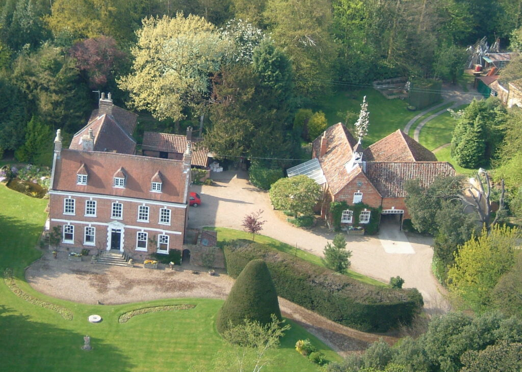 Aerial view of Brackenborough Hall with the hall on the left and building on the right