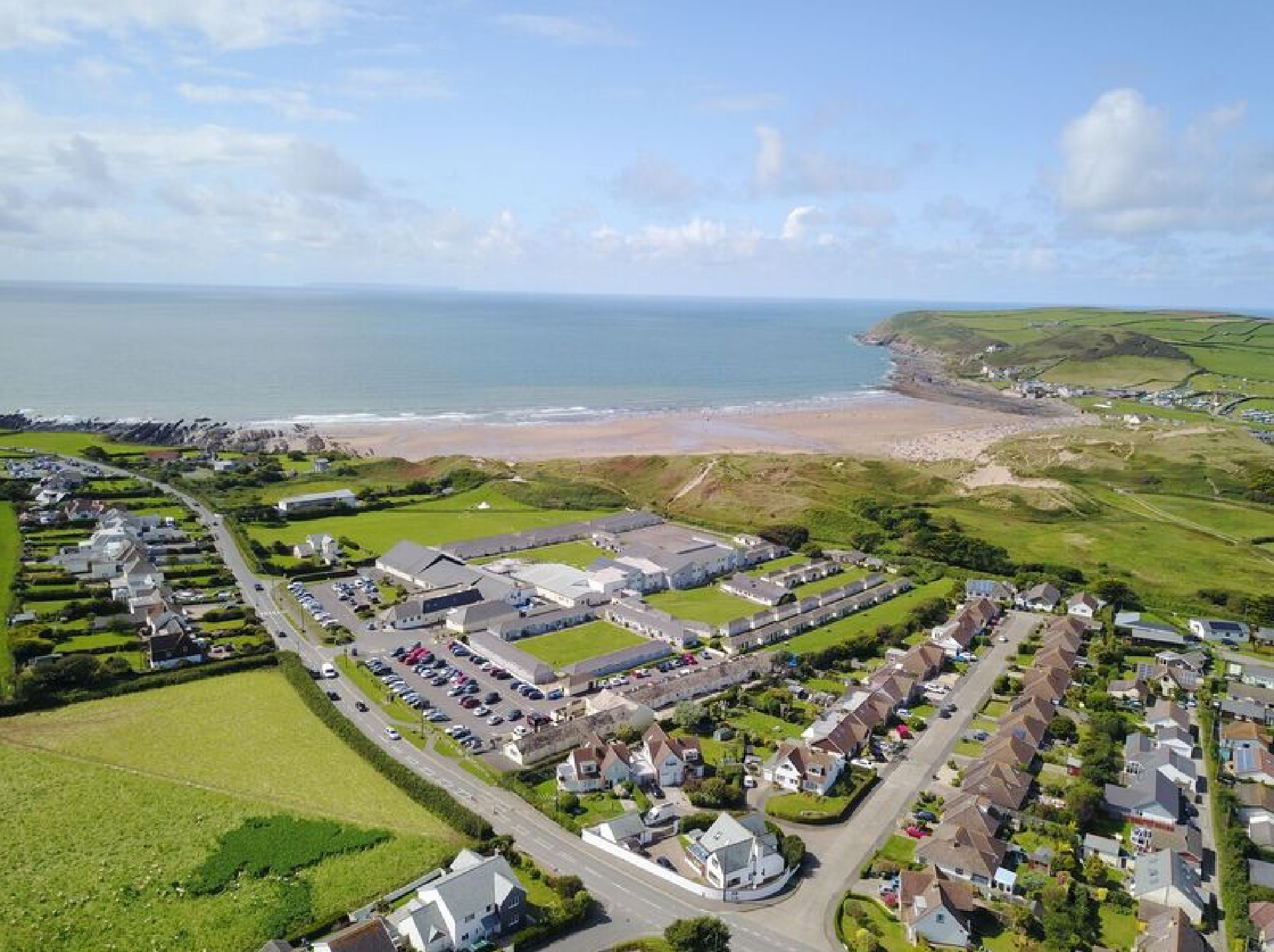 Croyde Bay resort - drone shot of the site looking down at the lodges and beach