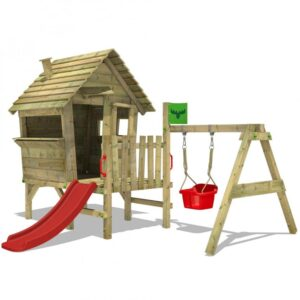 toddler size wooden playhouse on stilts and a red slide and a red swing hanging from a wooden frame
