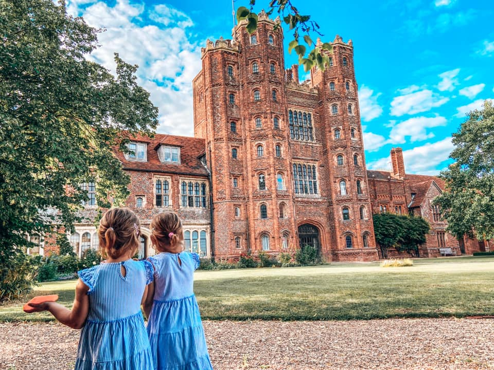 Layer Marney Tower with two girls to the left in blue dresses