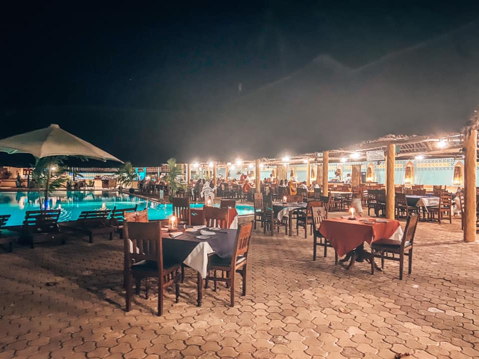 the dining area at night at the Turtle Bay beach resort. The tables are laid with table clothes