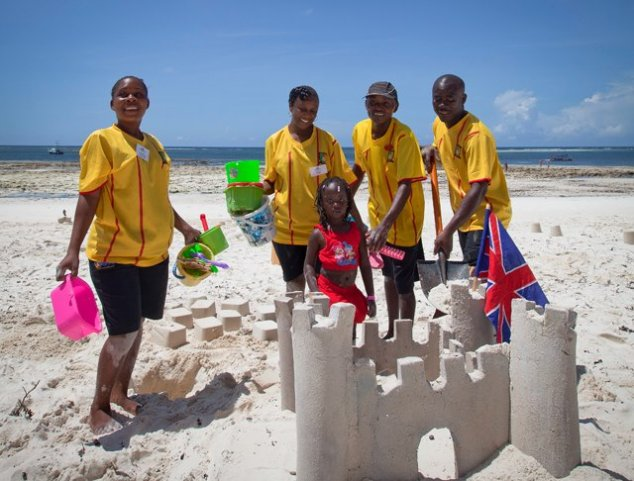 Children building a sandcastle in the kids club at the Turtle Bay resort kenya