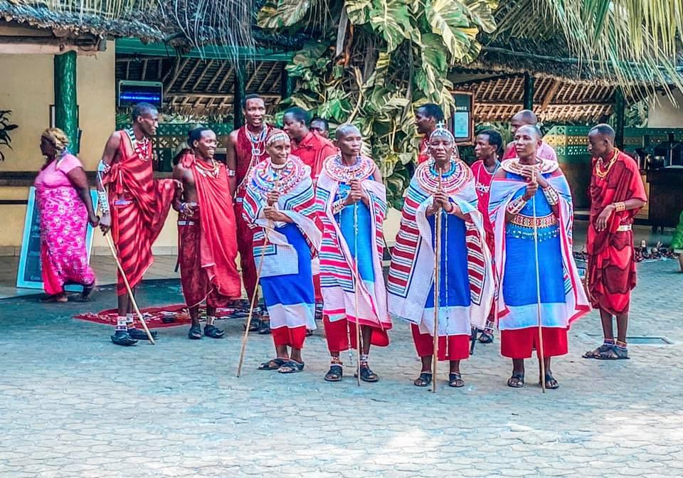 Maasai dancers dressed in traditional costumes dancing