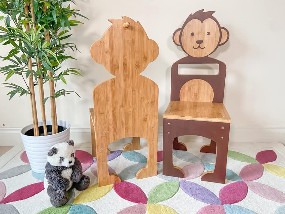 two wooden animal chairs positioned on a rug