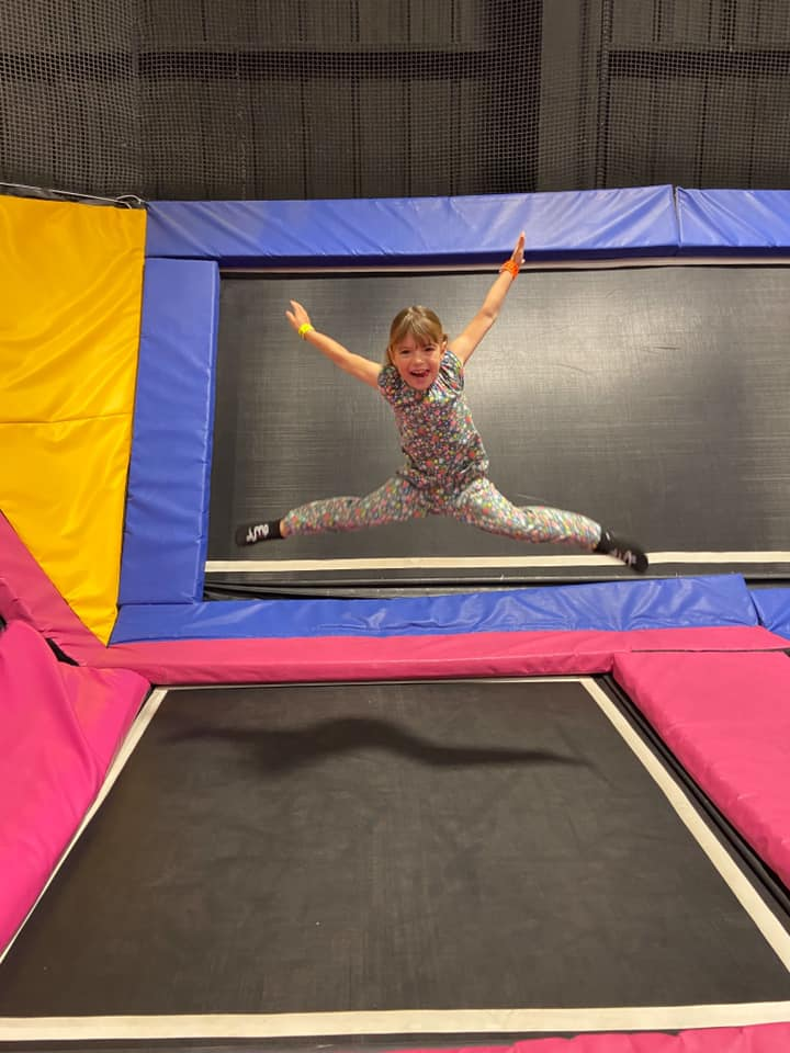 Young girl jumping on the trampoline at Jumpstreet - days out in essex