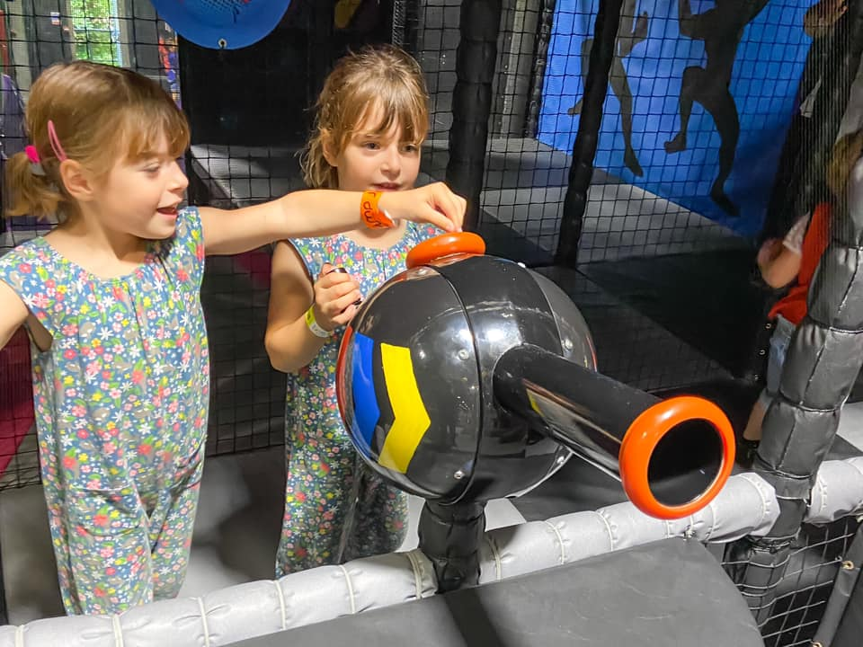 girls shooting balls at Kendricks soft play at Jump Street - days out in essex