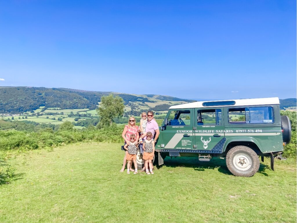 A family in front of a safari vehicle in Exmoor