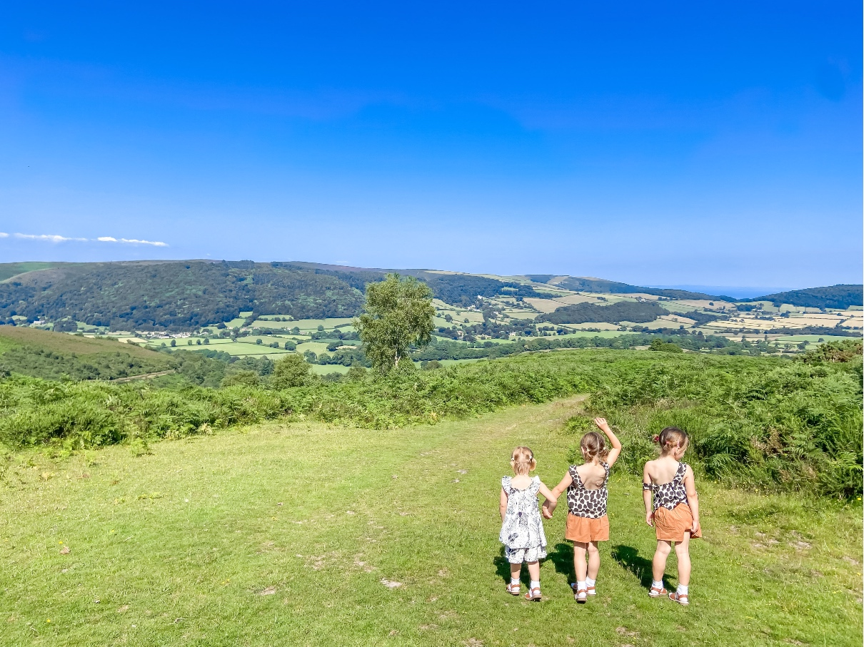 three young girls looking out over exmoor